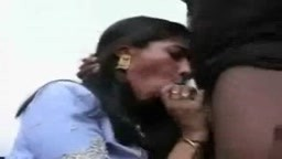 Indian babe giving foot blow job