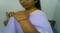 Beautiful Indian in white saree blows