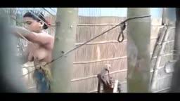 Village girl hidden cam outdoor bath filmed