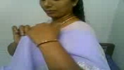 Beautiful Indian in white saree blows
