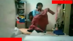 Desi bhabhi changing dress captured using hidden cam